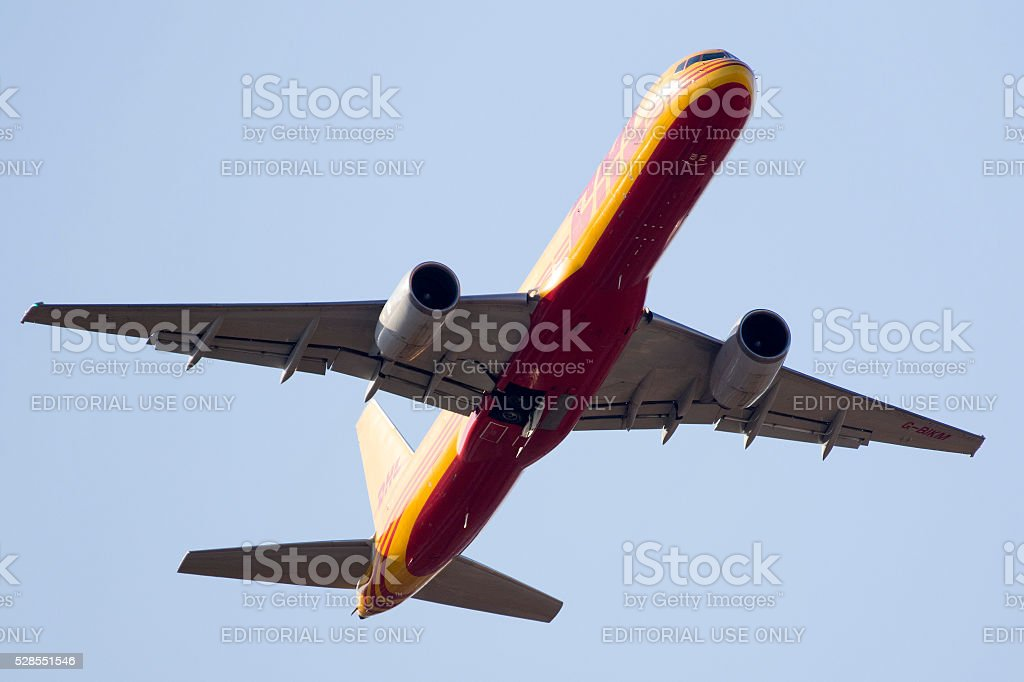 DHL Boeing 757 departing in the evening stock photo