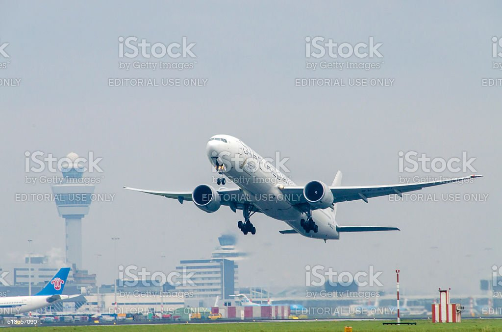 Boeing 777-312 of Singapore Airlines taking off at Schiphol. stock photo