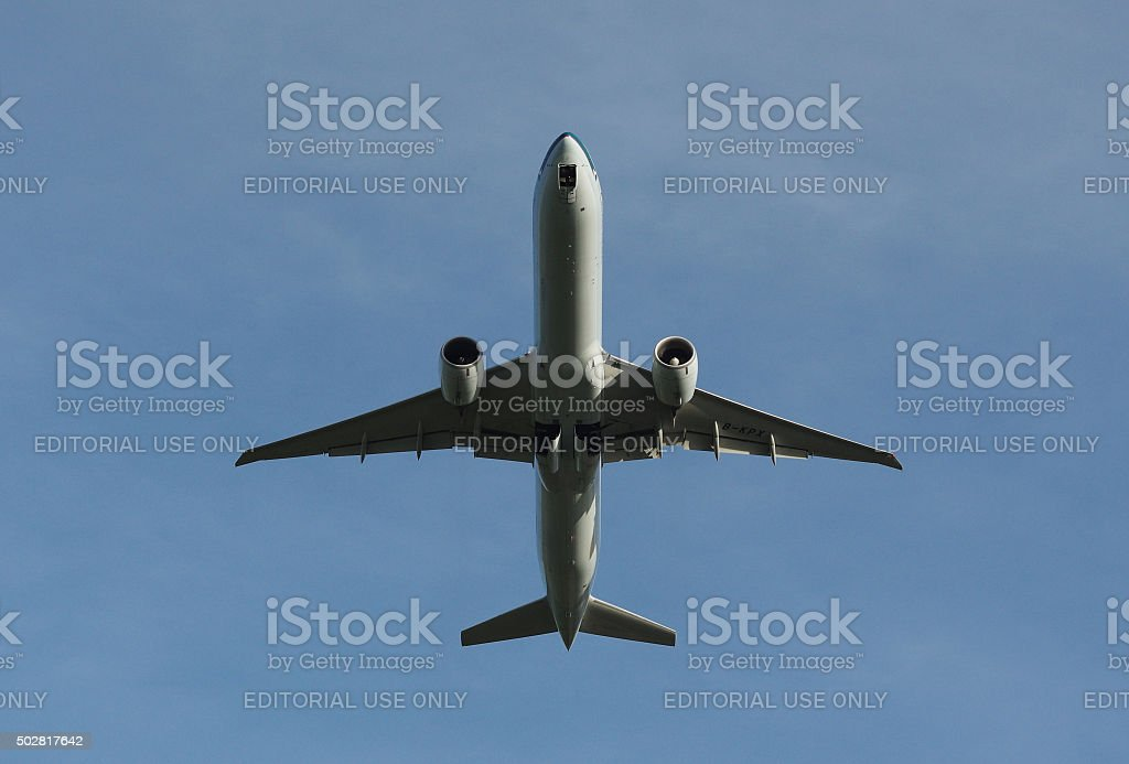 Boeing B777-300ER of Cathay Pacific while take-off stock photo