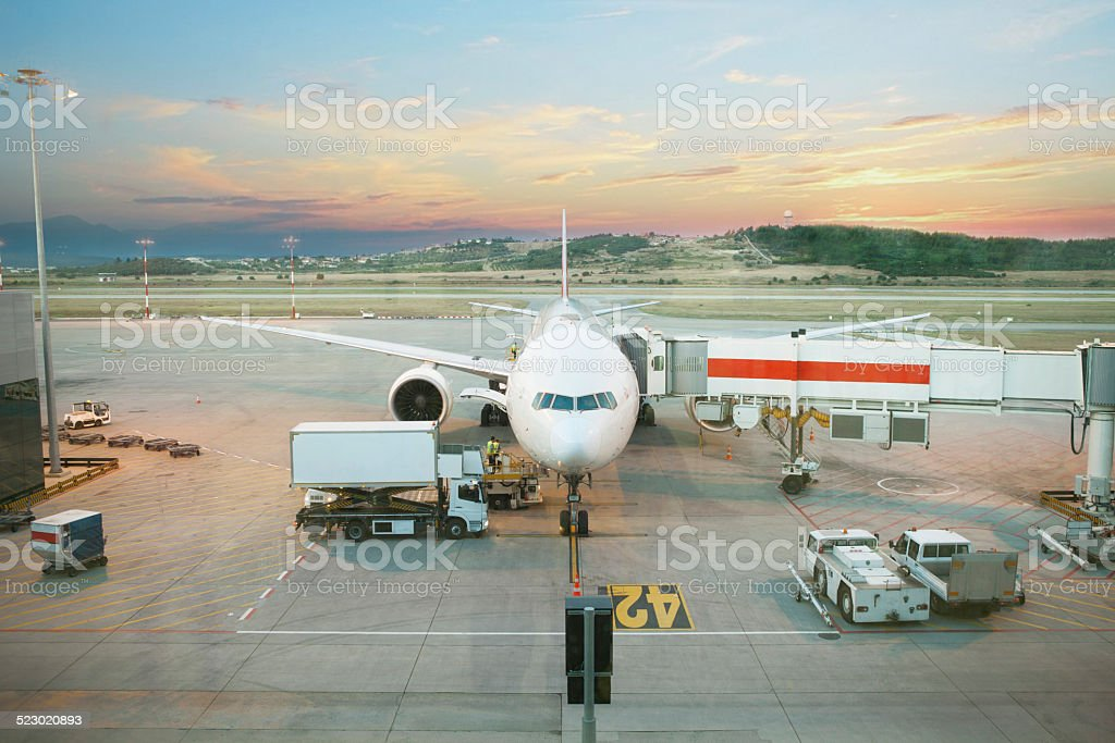 Boeing being loaded with cargo stock photo