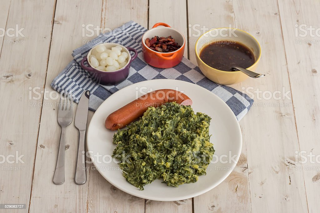 Boerenkool with smoked sausage on a white plate stock photo