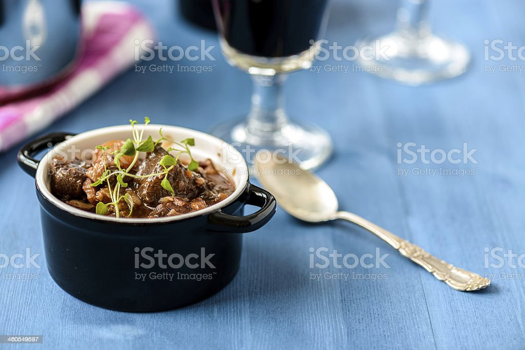 boeuf bourguignon classic french beef stew on blue table stock photo