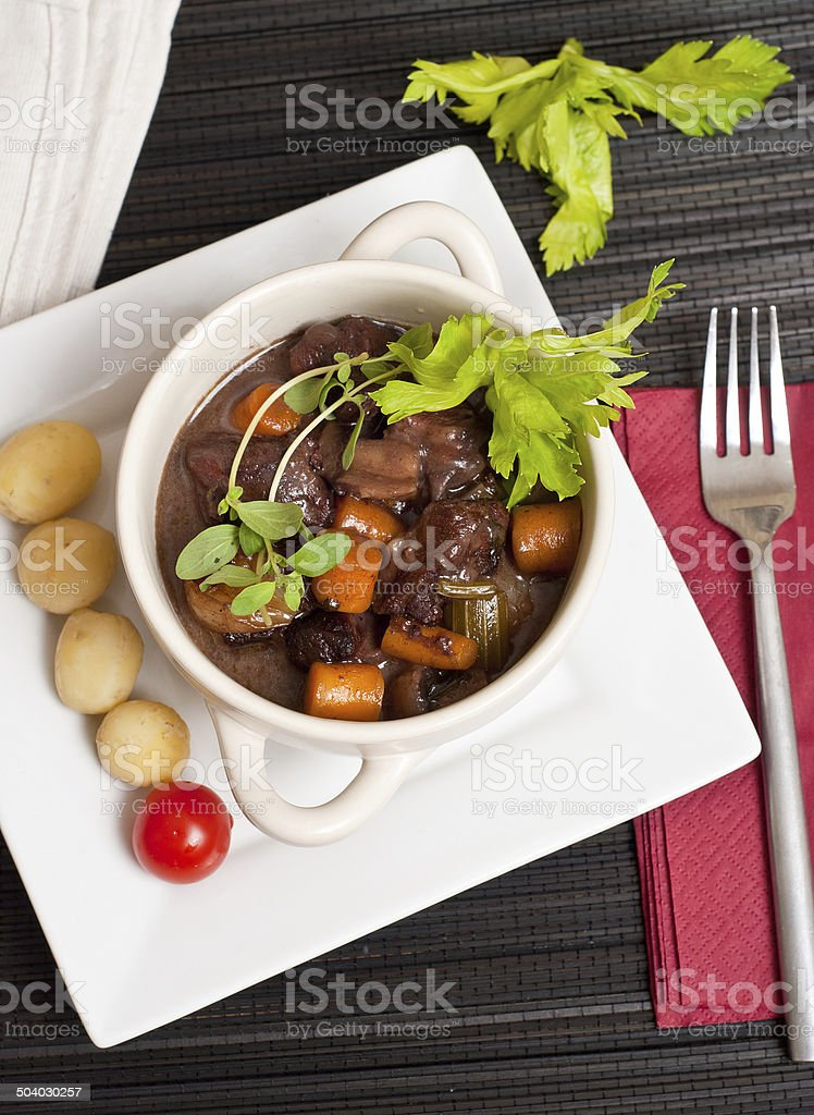 Boeuf bourguignon with fresh herbs stock photo