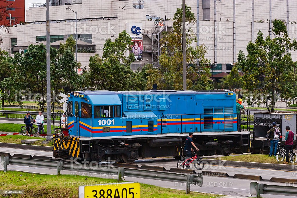 Bogotá, Colombia: diesel engine and train cross Avenida El Dorado. stock photo