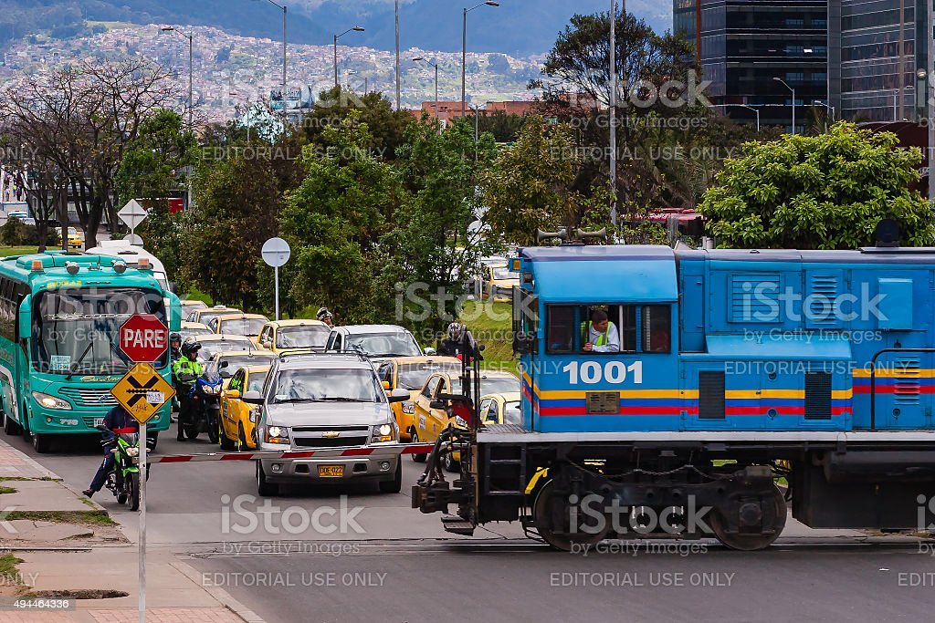 Bogotá, Colombia -  diesel railway engine crosses Avenida El Dorado. stock photo
