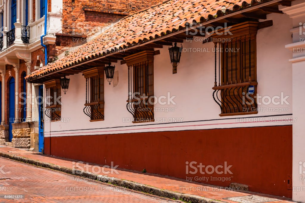 Bogotá, Colombia - Spanish Colonial Style Architecture and Windows in La Candelaria, the Historical Centre of the Capital City. stock photo