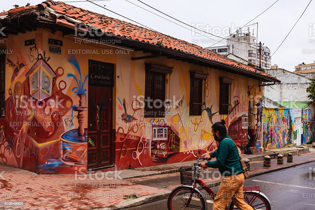 Bogota, Colombia - Cyclist and Street Art in La Candelaria stock photo