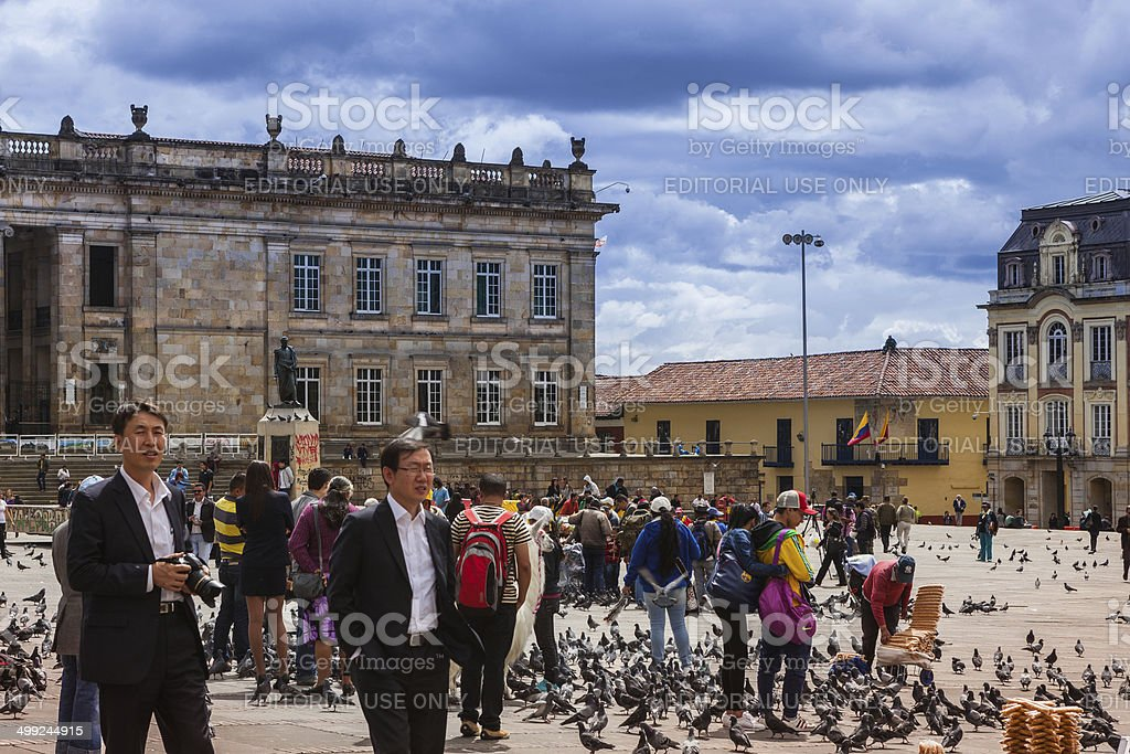 Bogota, Colombia - People and pigeons on Plaza Bolivar royalty-free stock photo