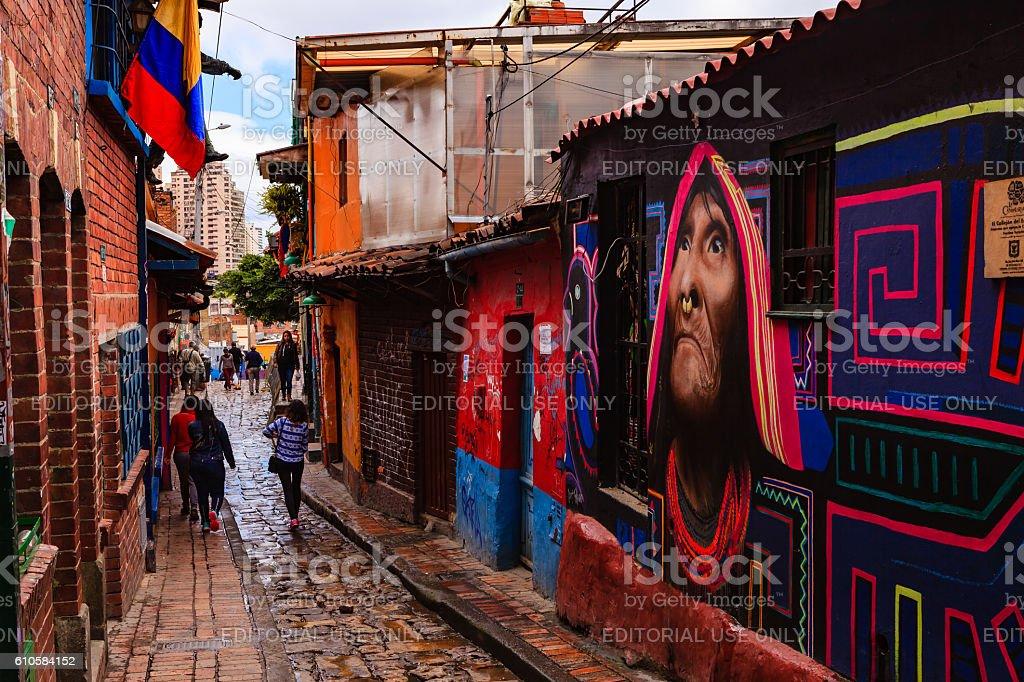 Bogota, Colombia: People walking down Carrera Segunda in La Candelaria stock photo