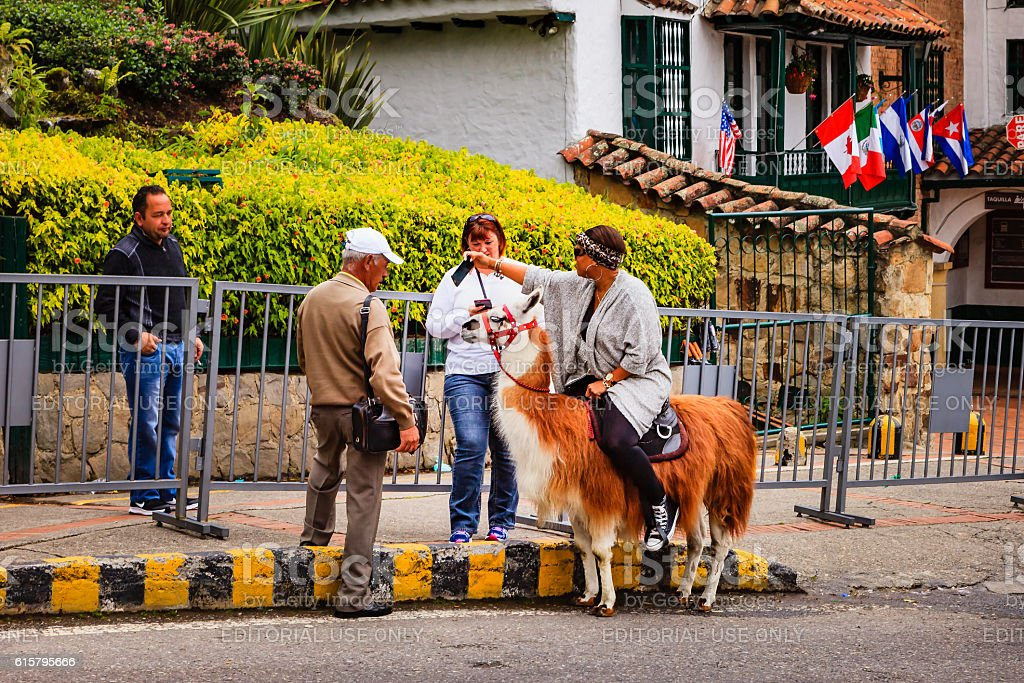 Bogota, Colombia - Tourist on Llama shoots Selfie on cellphone stock photo