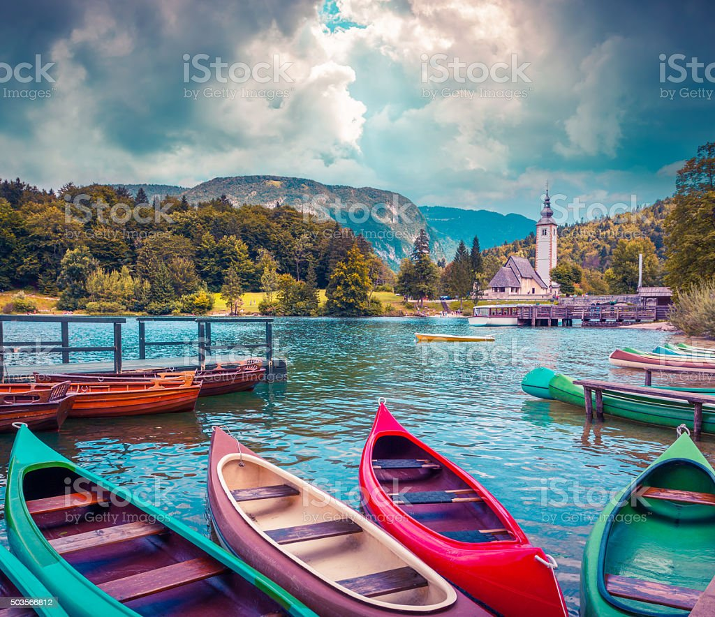 Bohinj Lake with boats stock photo