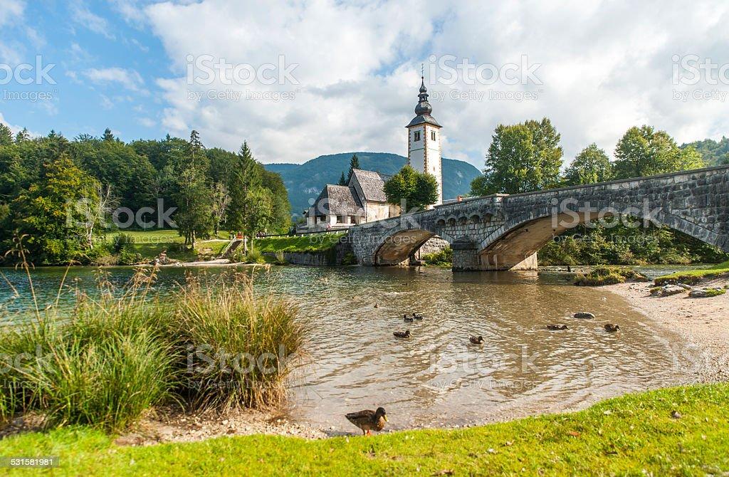 Bohinj lake with church and bridge, Slovenia stock photo