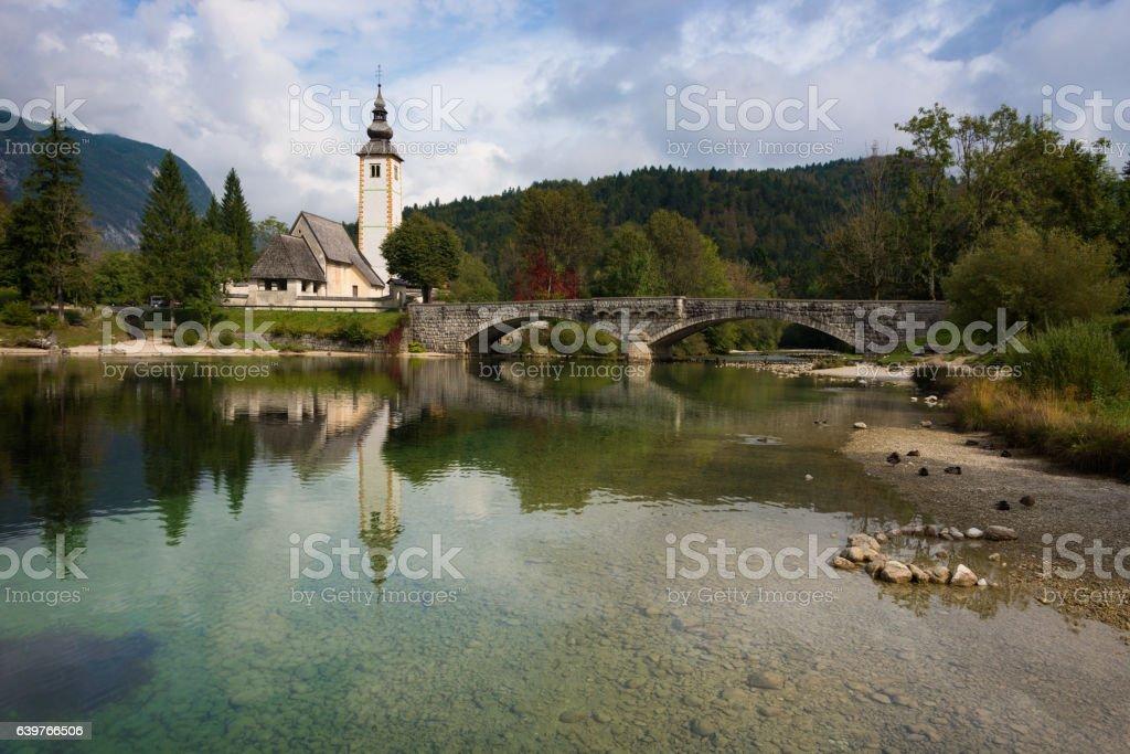 Bohinj lake with church in Slovenia stock photo