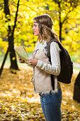 Boho girl holding travel map