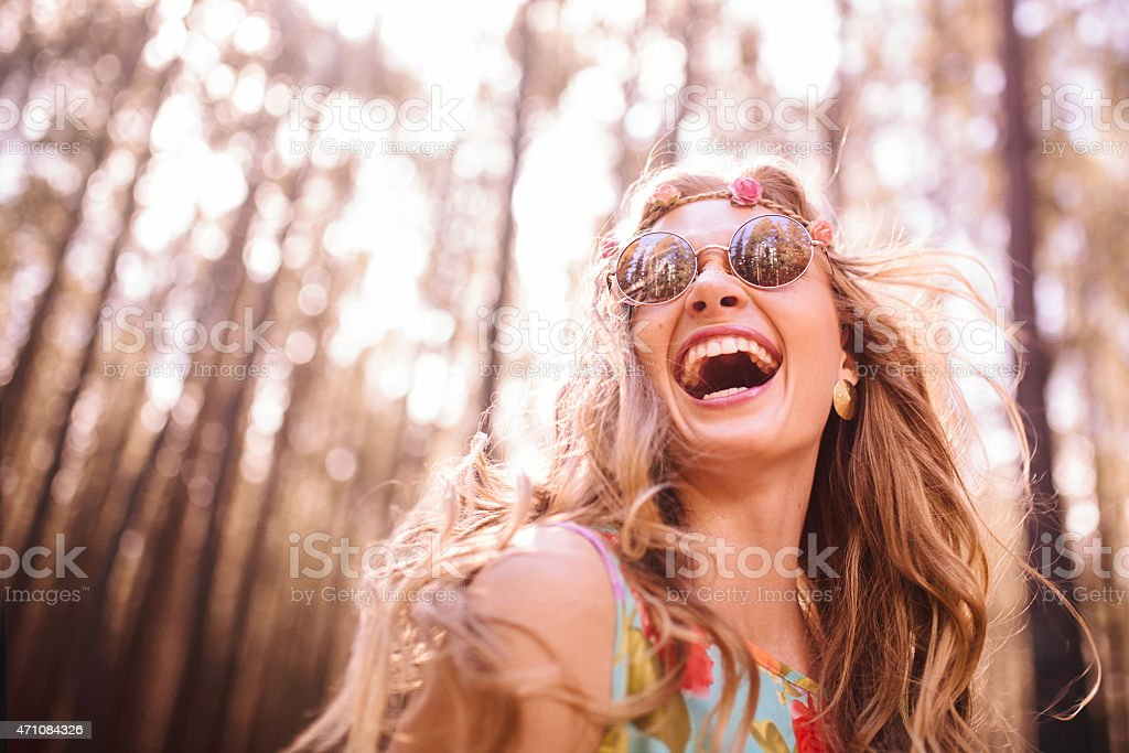 Boho girl laughing in a summer forest stock photo