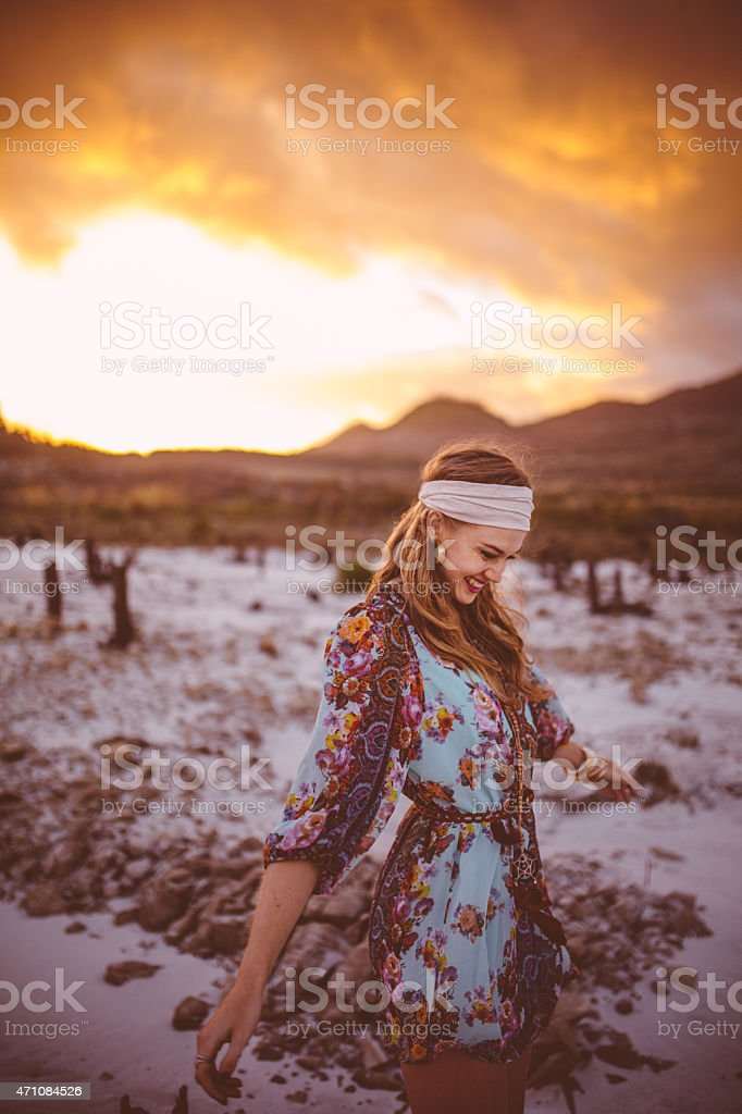 Boho girl walking in nature on a summer evening stock photo