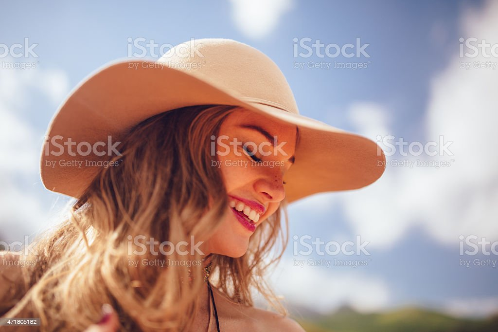 Boho girl wearing a fashionable summer hat stock photo