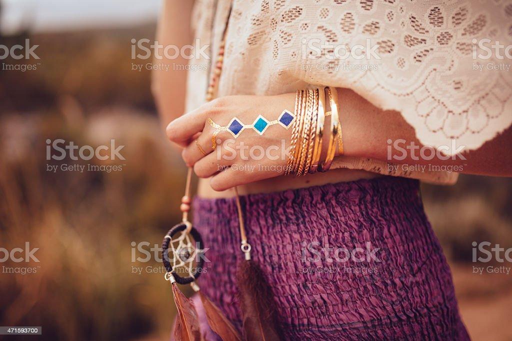 Boho girl with jewellery and temporary tattoo stock photo