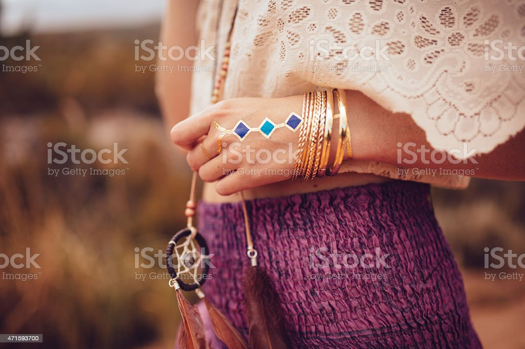 Boho girl with jewellery and temporary tattoo stock photo