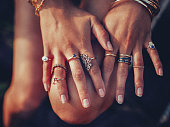 Boho girl's hands looking feminine with many rings