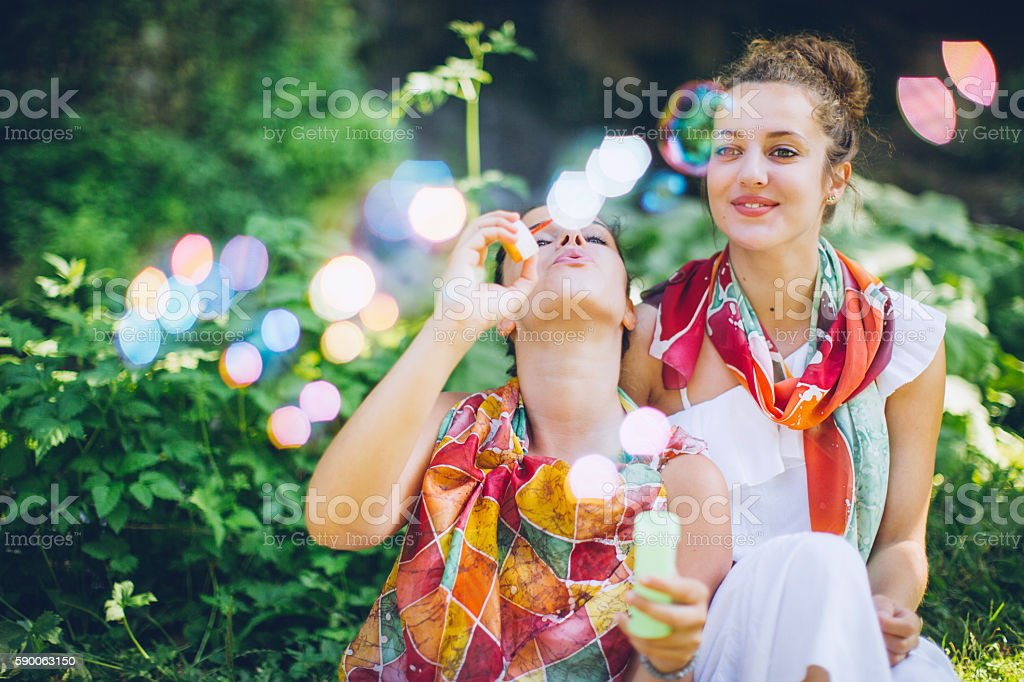 Boho girls surrounded by nature in spring stock photo