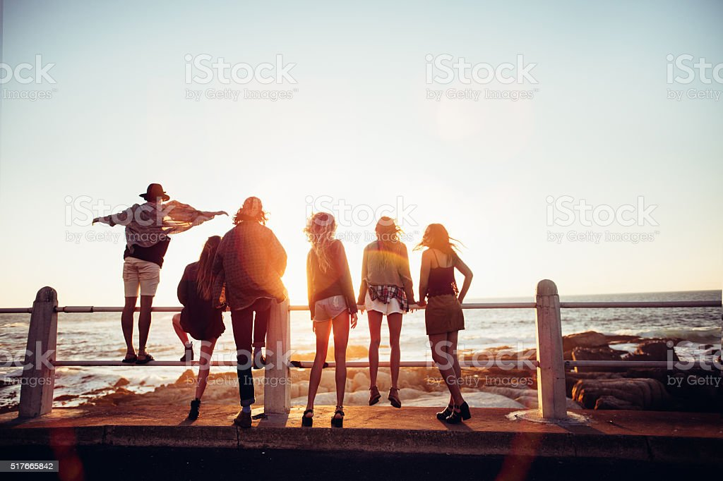 Boho style friends reaching the beach on a road trip stock photo