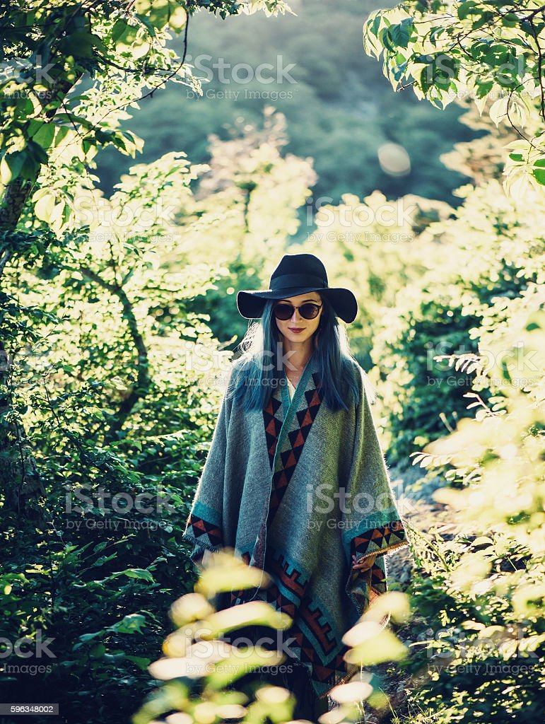 Boho style girl in the forest stock photo