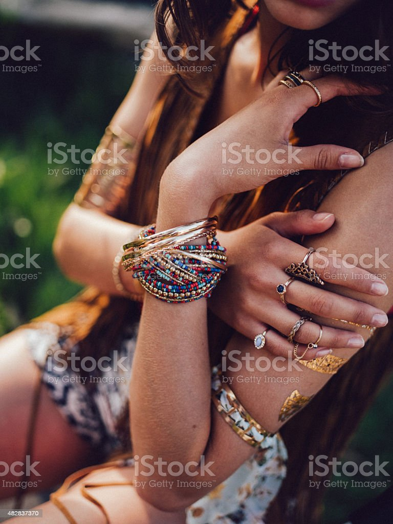 Boho style girl with bangles and rings stock photo