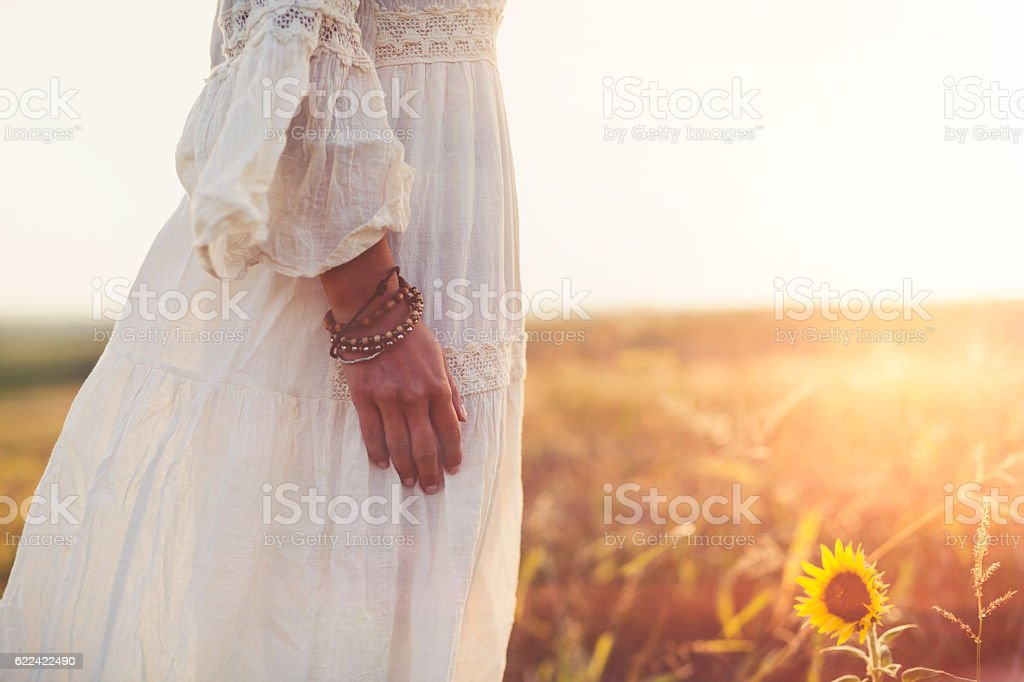 Boho woman relaxing in meadow stock photo