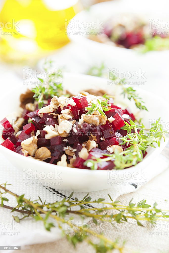 boiled beets with walnuts, salad in a small  bowl royalty-free stock photo