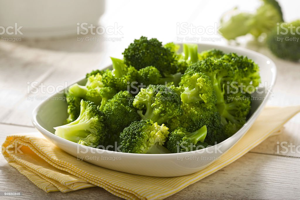 boiled broccoli in a bowl stock photo