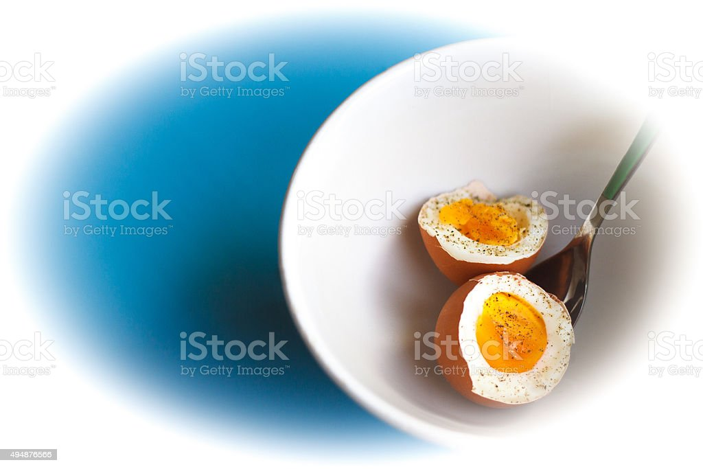 Boiled Brown Egg (Halved), White Bowl, Blue and White Background stock photo