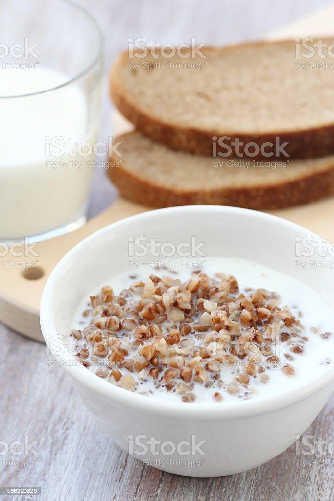 Boiled buckwheat with milk stock photo