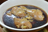 boiled chicken leg in fish sauce and brown soup