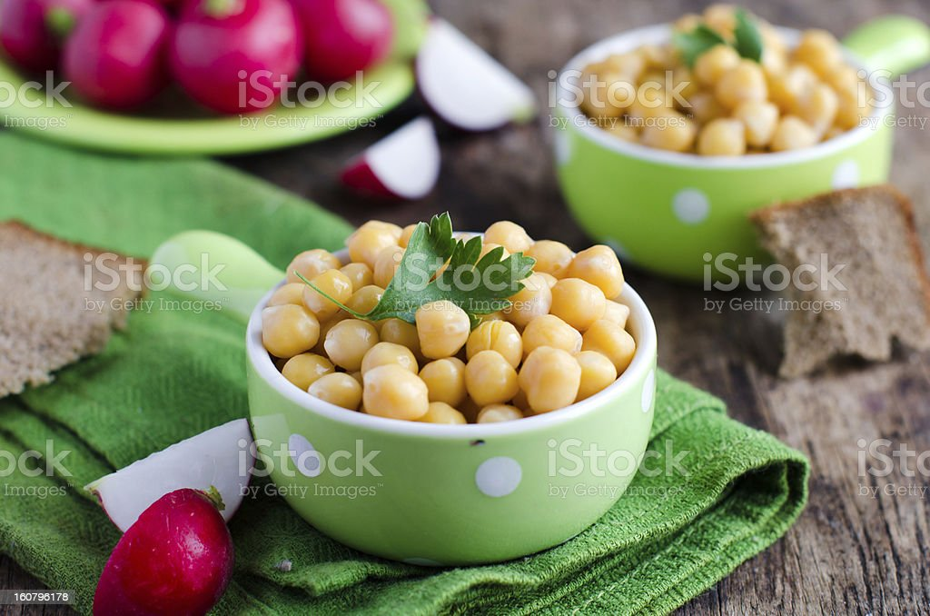 Boiled chickpeas with parsley royalty-free stock photo