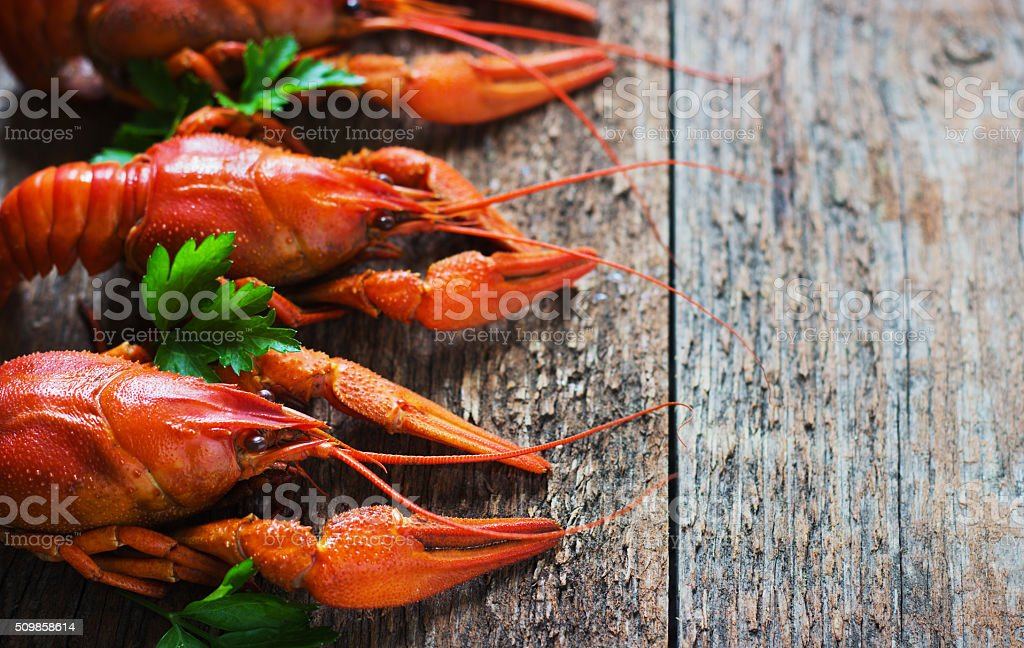 Boiled crayfish on a wooden background. stock photo