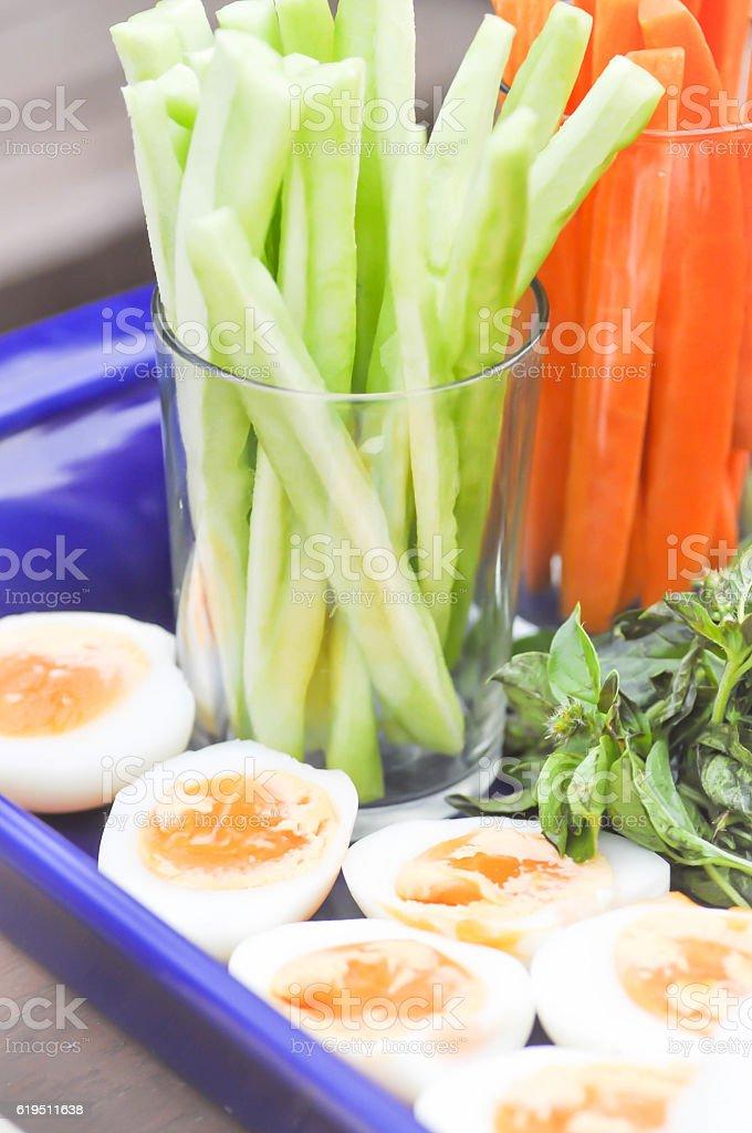 boiled egg, carrot, and momordica charantia stock photo