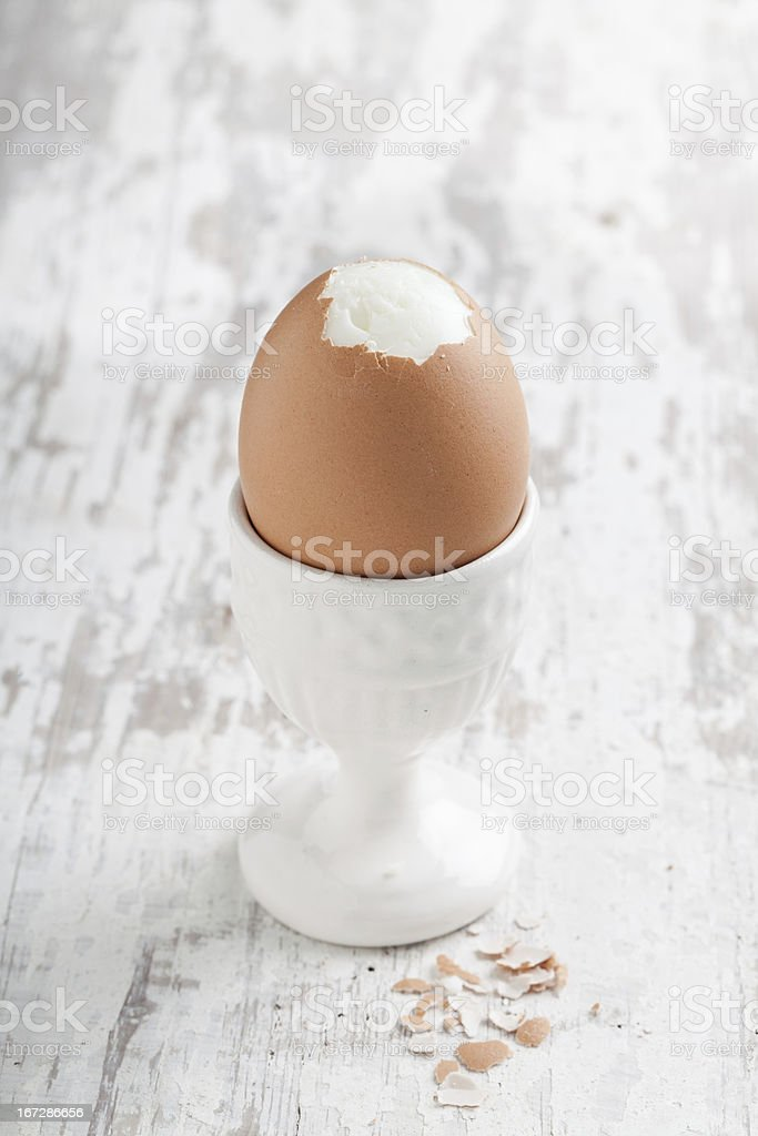 Boiled egg in an eggcup stock photo