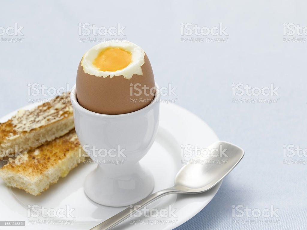 boiled egg on blue stock photo