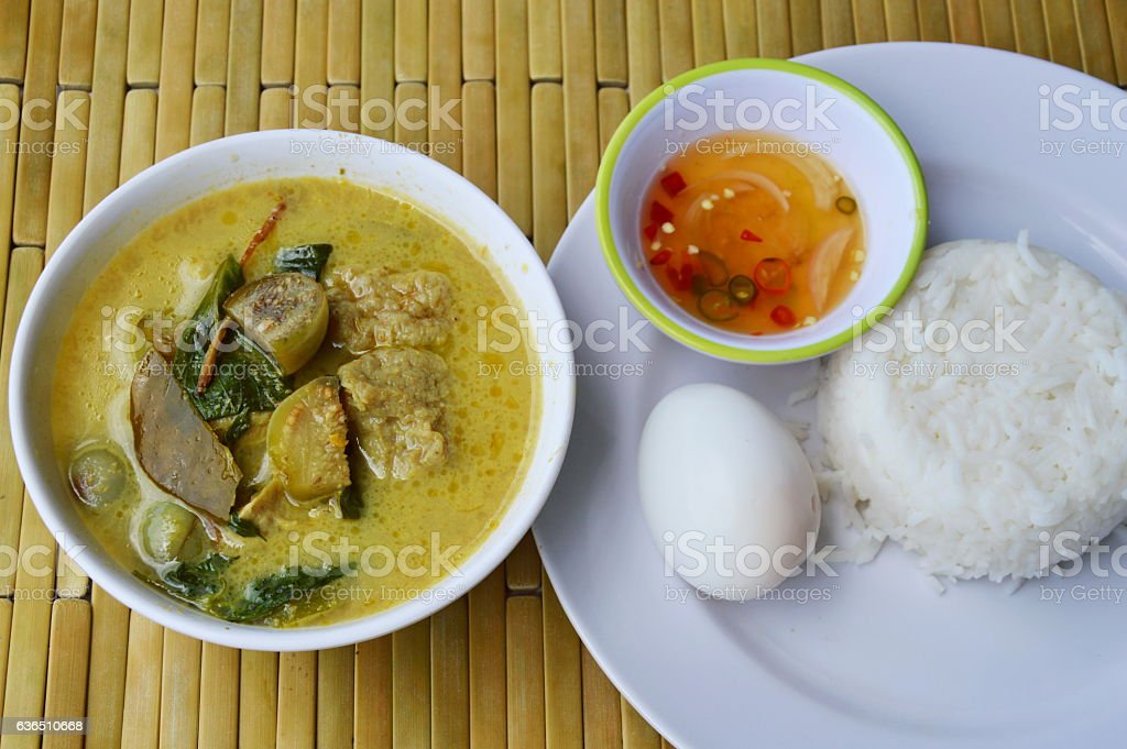 boiled egg on rice and spicy fish ball green curry stock photo