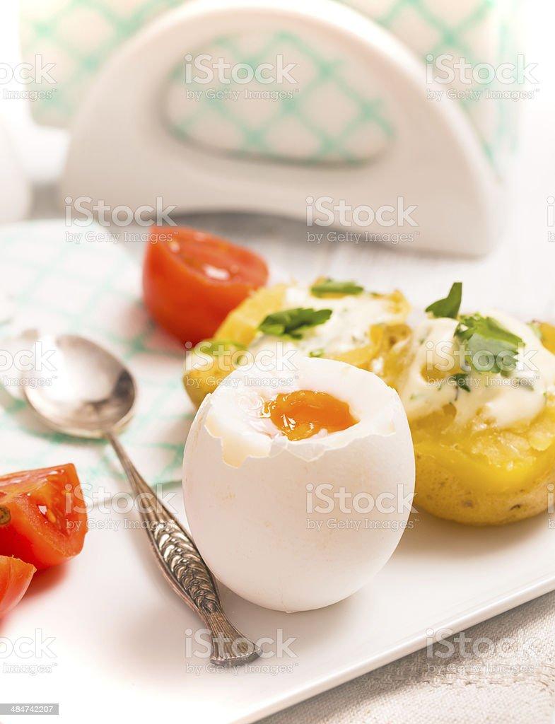 Boiled egg with potato stock photo