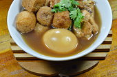 boiled egg with tofu and chicken in Chinese brown soup