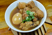 boiled egg with tofu and chicken in Chinese herb soup