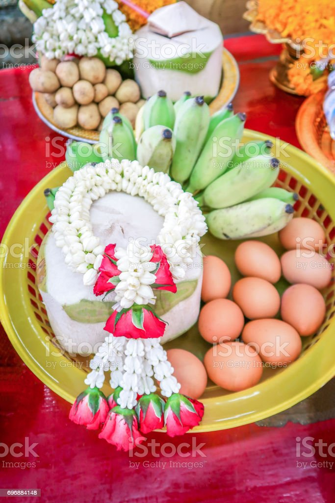 Boiled eggs coconut and banana to oblation vow, traditional ceremony in Thailand stock photo