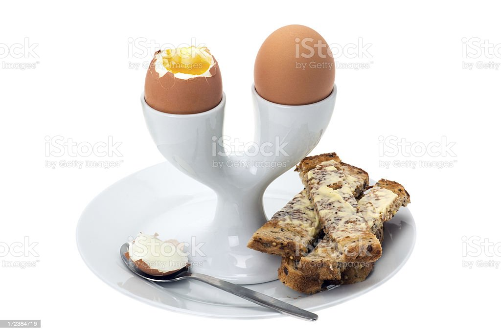 Boiled eggs in a two egg eggcup royalty-free stock photo
