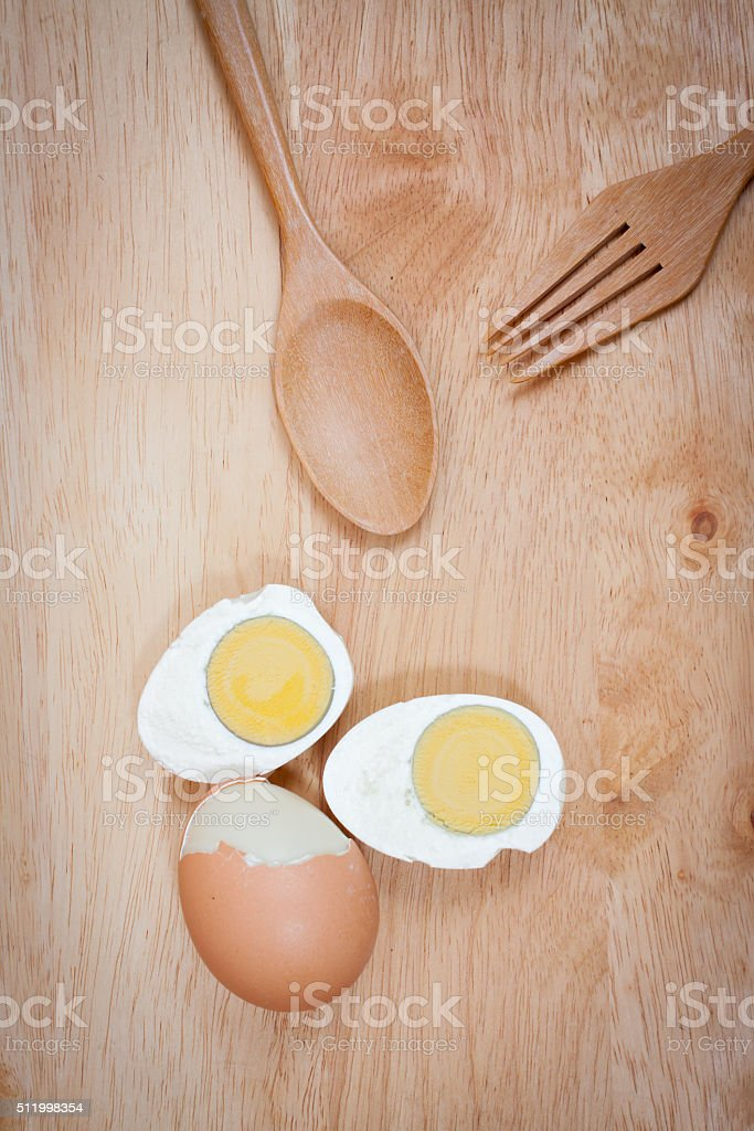 Boiled eggs on wooden background stock photo