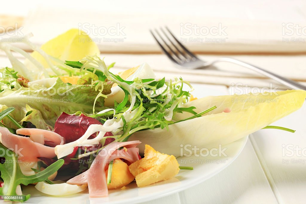 Boiled eggs with smoked ham and vegetables stock photo