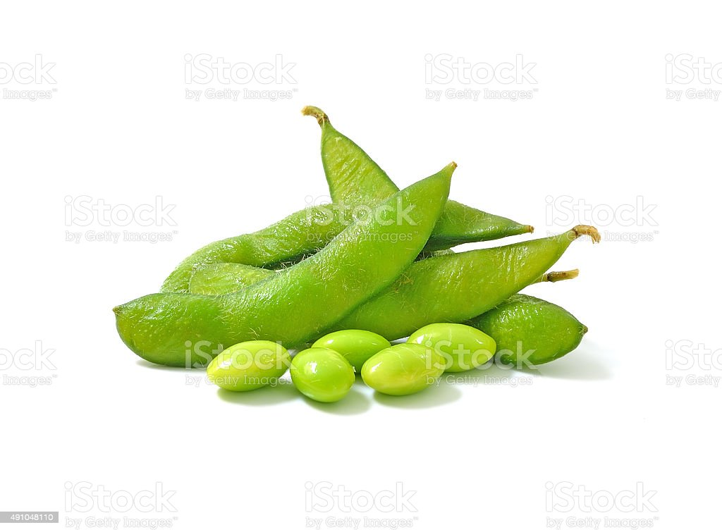 boiled green soy beans, japanese beans on white background stock photo
