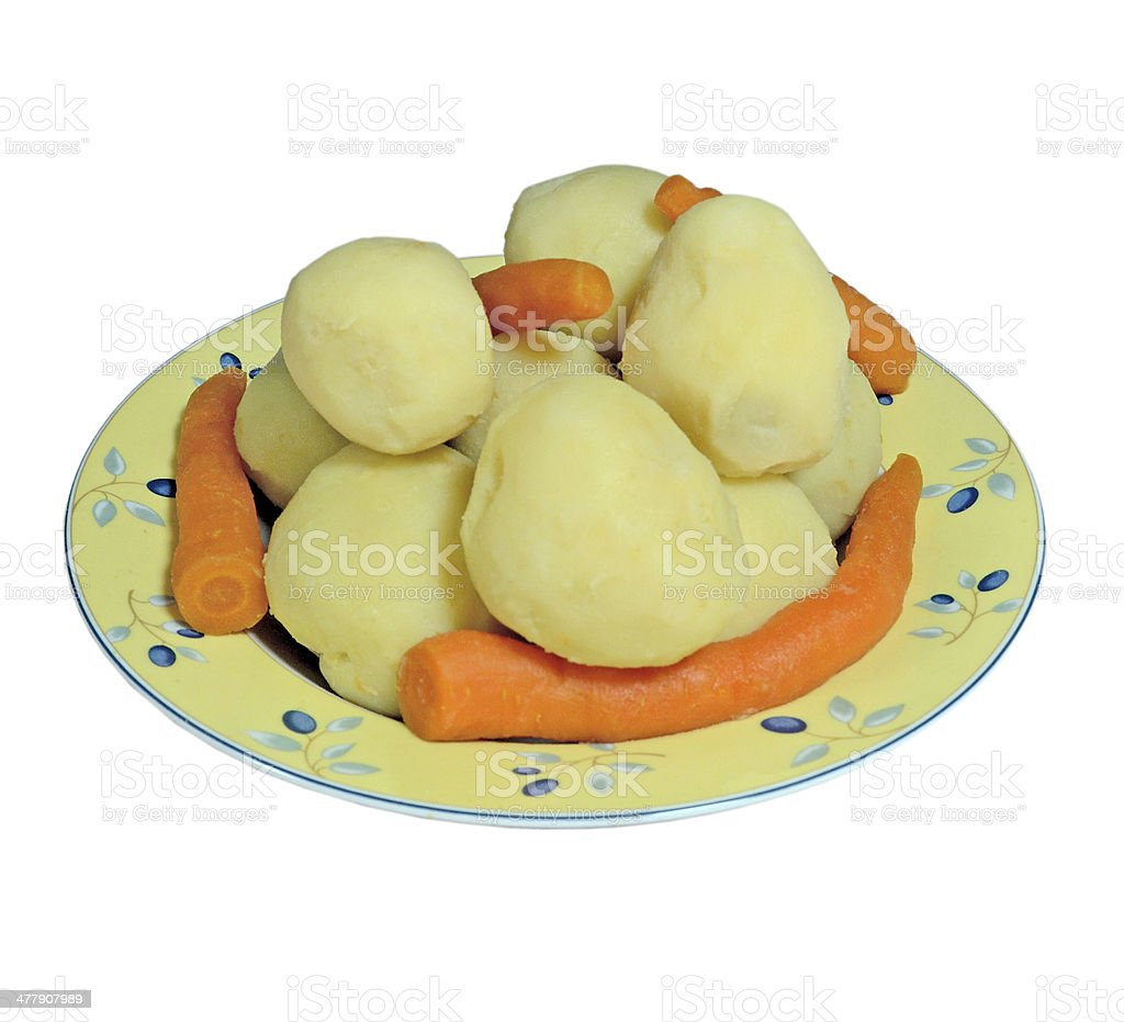Boiled potatoes and carrots on a platter royalty-free stock photo