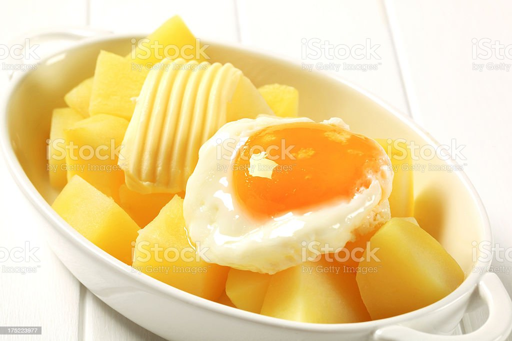 Boiled potatoes and fried eggs royalty-free stock photo